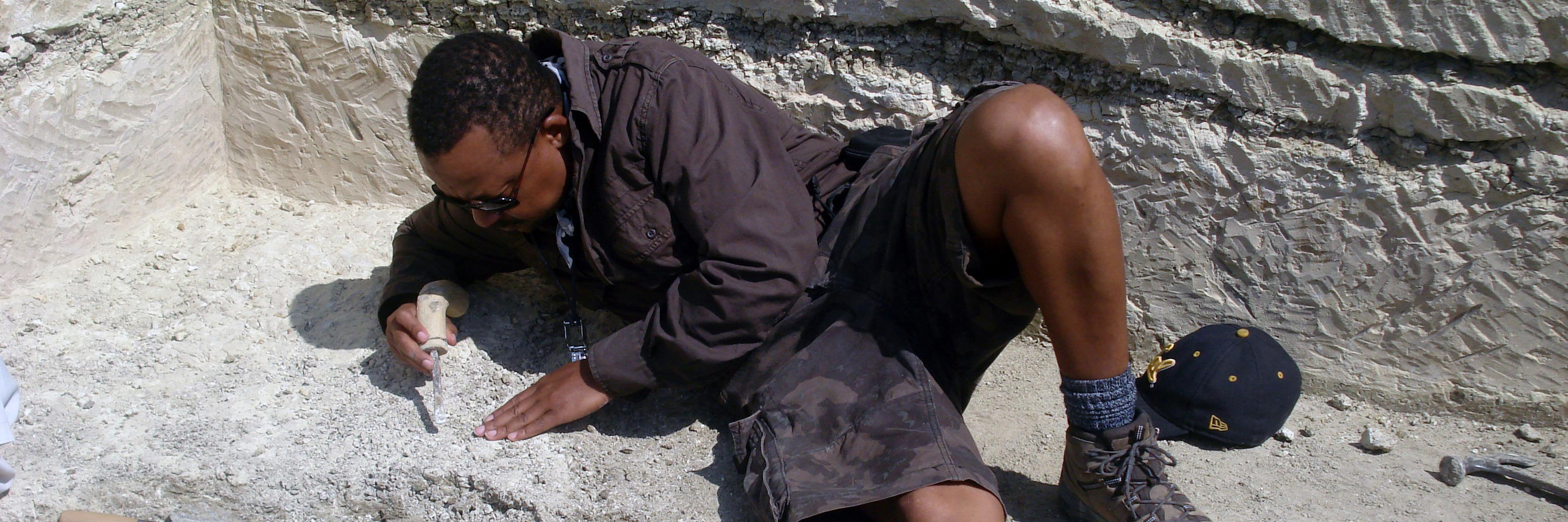 Student performing geological research in the field