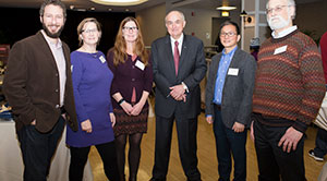 Faculty pose for the camera with President McRobbie